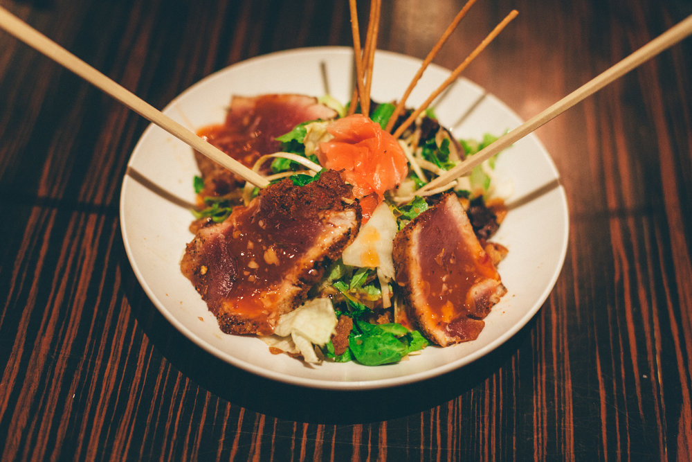 Ahi Tuna Salad: Blackened yellowfin tuna, Asian slaw, pecans, asparagus tips, crispy wontons and ponzu-peanut vinaigrette