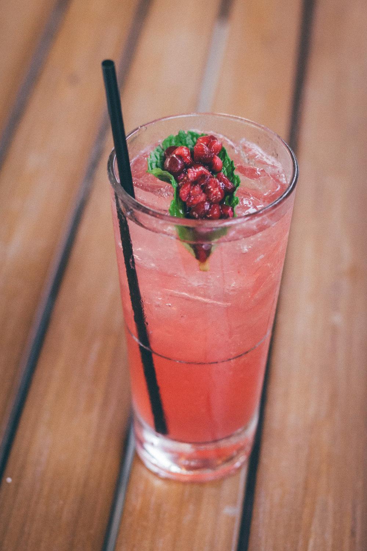 Pom Collins:Tito's Vodka, Pama Liquor, House Made Sour Mix, Simple