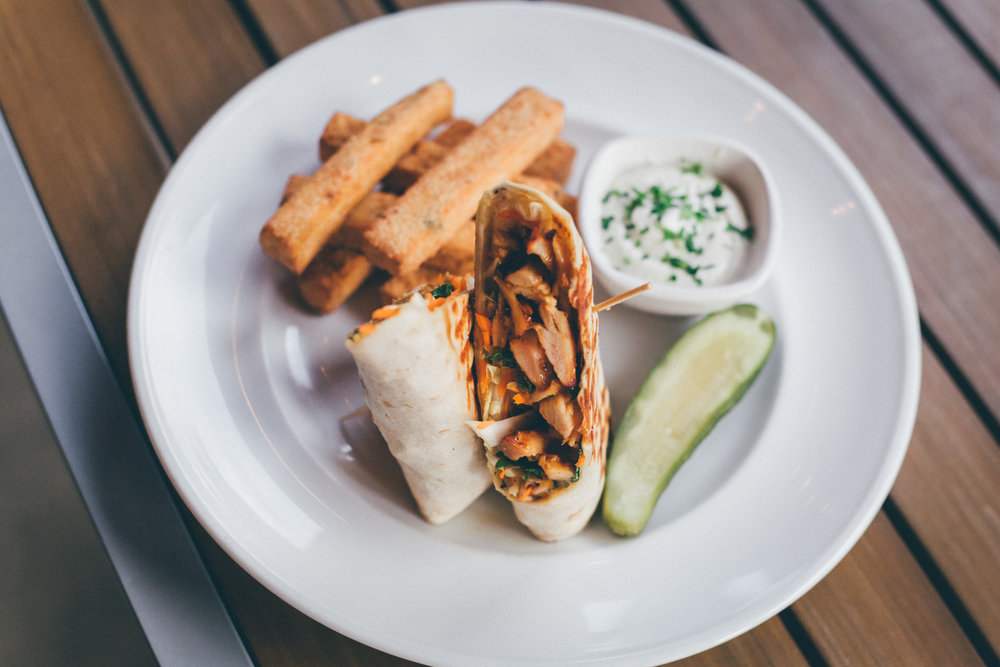 Banh Mi Chicken Wrap: Soy Glazed Chicken, Roasted & Pulled or Fried, Napa Cabbage, Pickled Veggies, Fresh Cilantro, Firecracker Sauce in Grilled Tortilla
