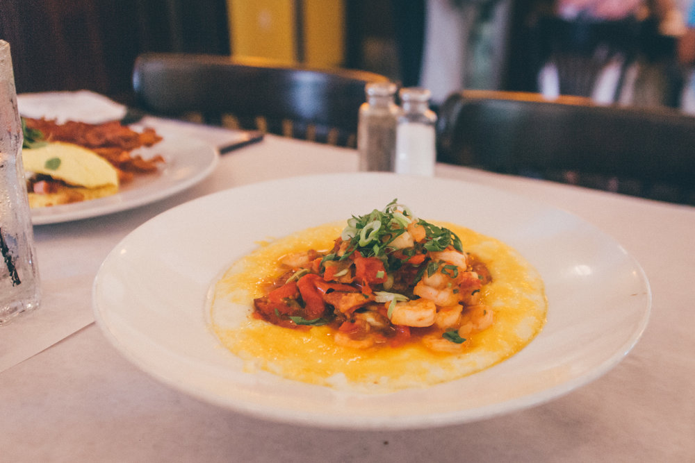Andouille Sausage & Shrimp Ragout: Roasted pepper, caramelized onion, cheddar grits