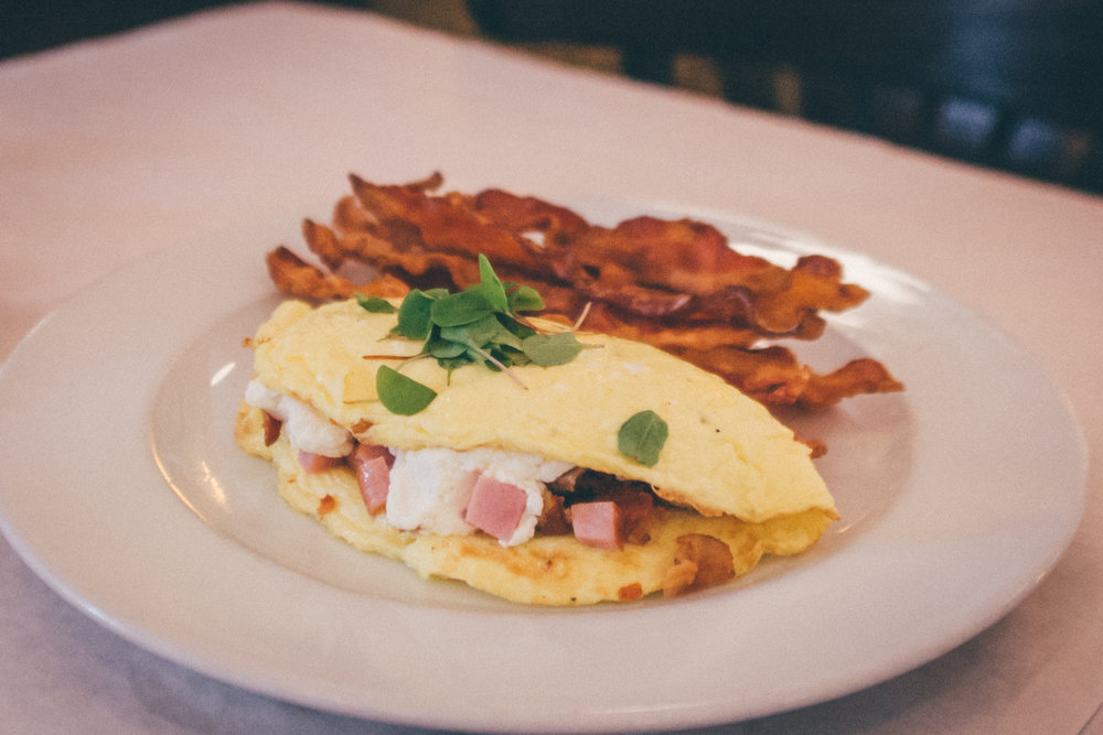 Meat Lover's Omelet: Breakfast sausage, smoked ham, bacon, cheddar (subbed with goat cheese)
