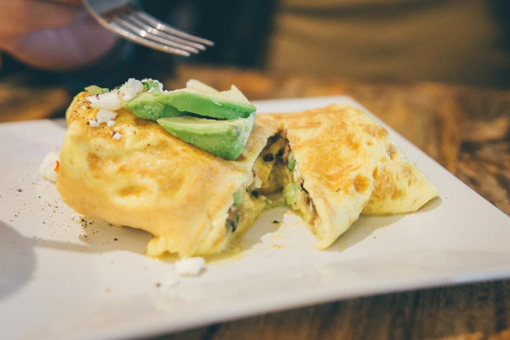 Omelette from Kôfē: Mushrooms, scallions, feta, bacon, sausage and avocado