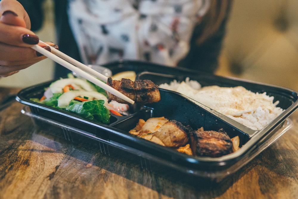 Korean Breakfast Bento from North Star Eatery: Crispy pork belly over kimchi, fried egg, jasmine rice.