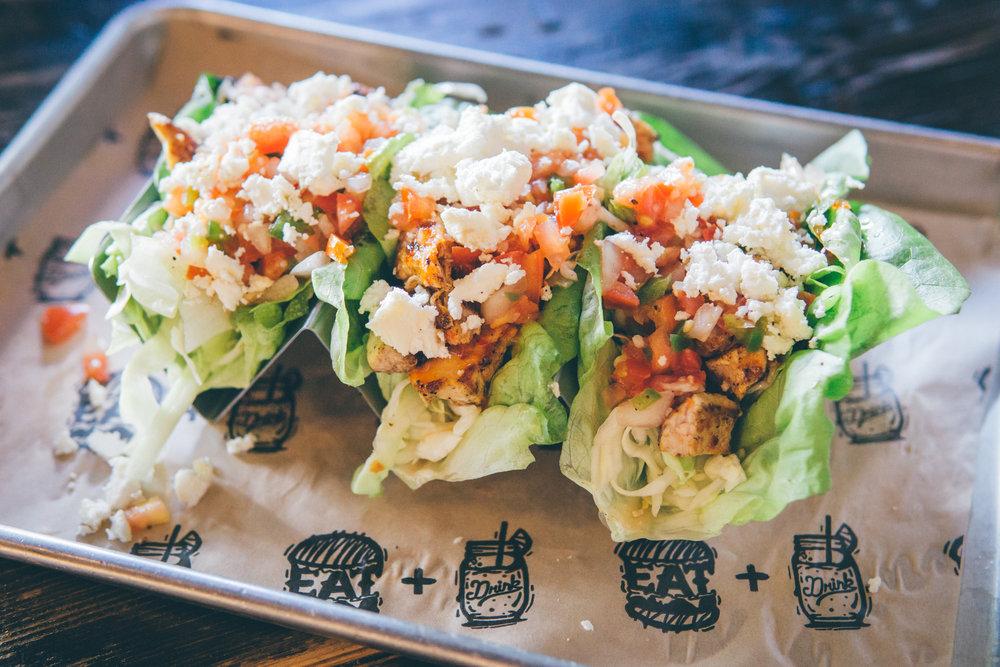 Lettuce Wraps: Grilled Chicken, Cabbage, Sour Cream, Sweet Thai Chili, Pico, Avocado, Queso Fresco, Cilantro, Bibb Lettuce