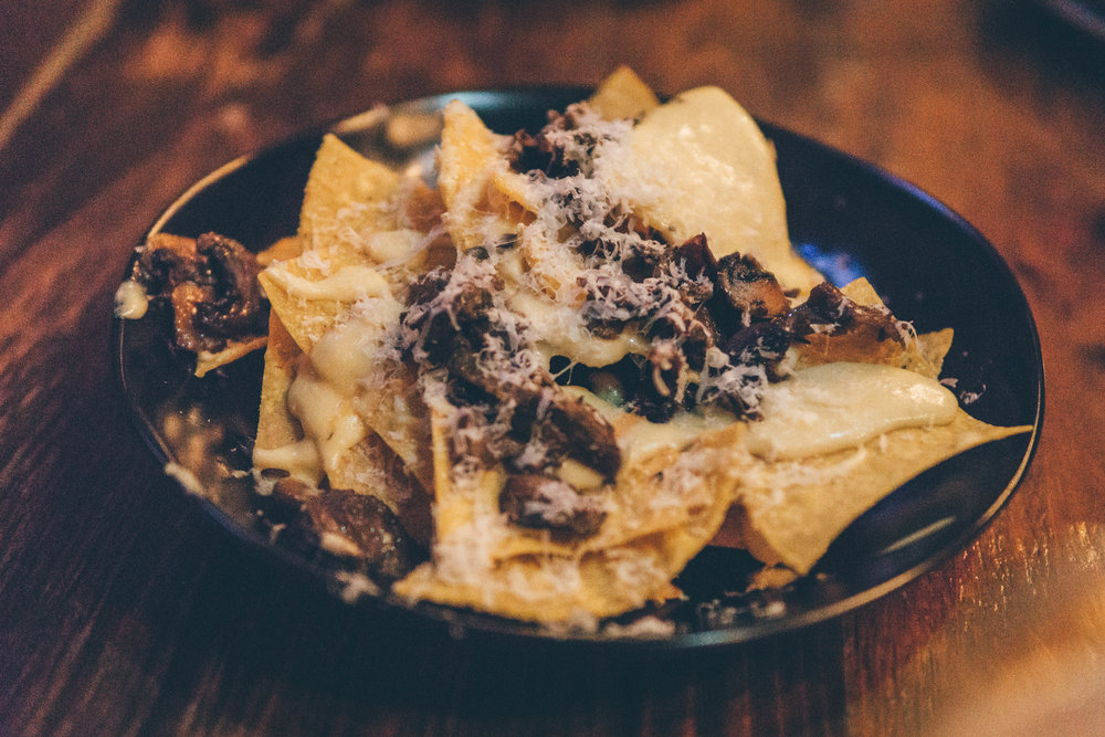 Truffle Nachos: House-Fried Tortilla Chips, Truffle Mornay & Roasted Mushrooms