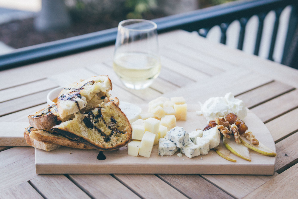 House Cheese Board: Black truffle cheese, fresh mozzarella, goat cheese, gorgonzola, parmigiano-reggiano. Served with pears, dates, king walnuts, honey & wood-fire toasted Neapolitan bread