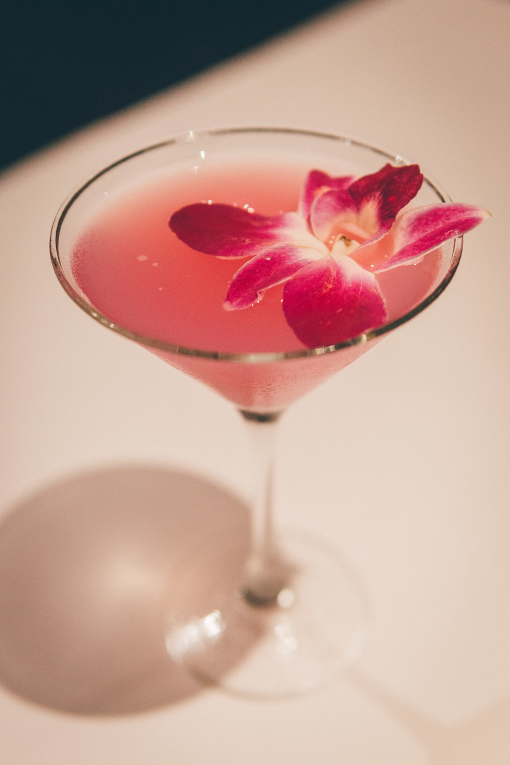 Wild Orchid Hawaiian Martini: Cruzan Guava rum, pineapple juice, Zico coconut water and desert pear and coconut flavors, finished with a floating edible orchid