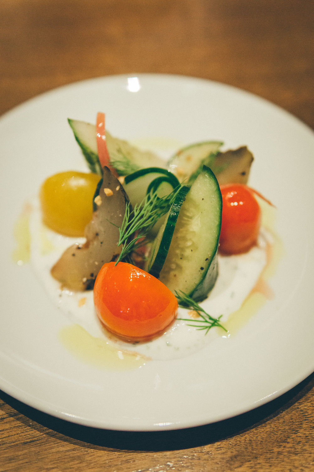 Cucumber & Heirloom Tomato Salad - pickled red onion, herb yogurt, dill, crispy garlic, red wine vinegar