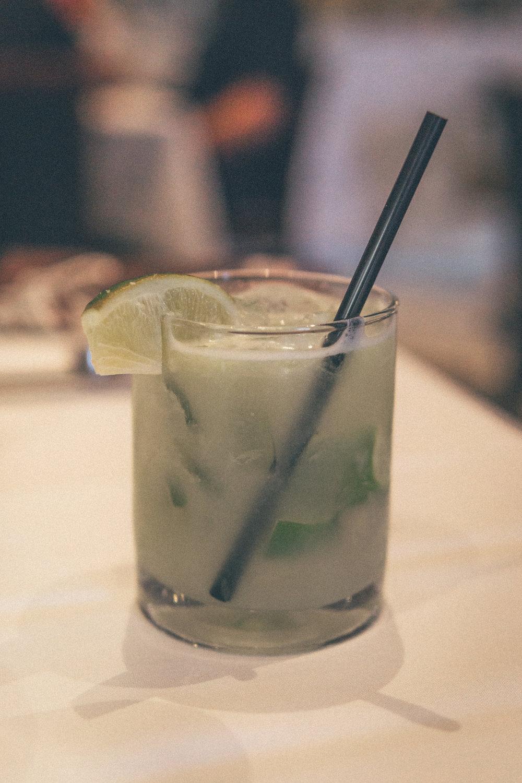Classic Caipirinha: Lime muddled with cane sugar and cachaça