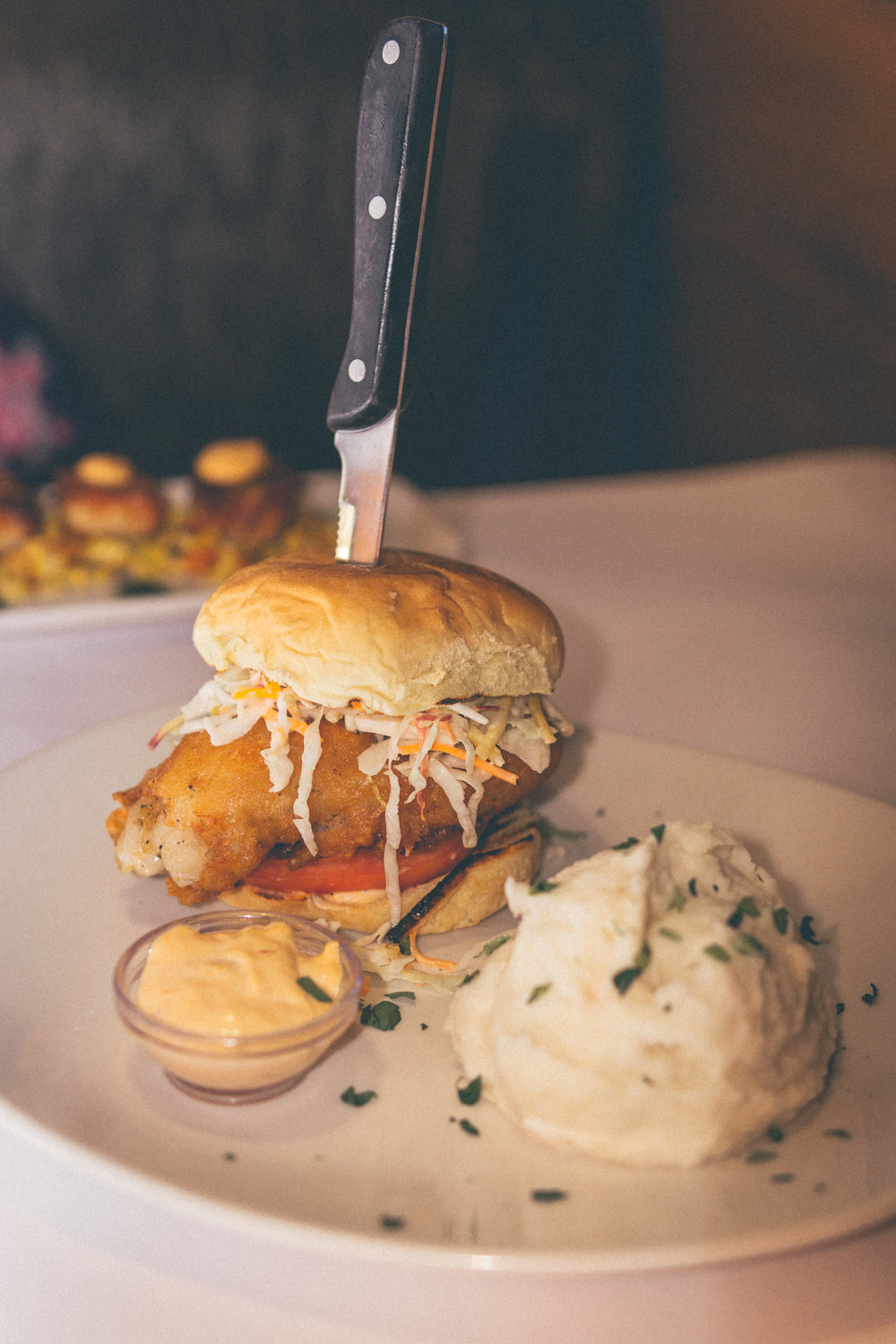 Bangin' BFG Sandwich: Fresh fish fillet, dressed with Bang Bang sauce, house-made coleslaw & a tomato slice.