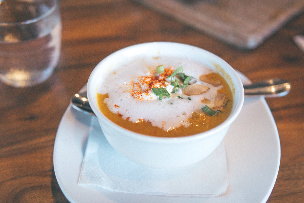 Caribbean Pumpkin Crab Bisque: Rich housemade bisque, toasted almonds, green onions, dollop of cream
