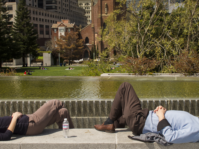 Enjoying the sun during their lunch break. Yerba Buena Gardens. San Francisco, CA.