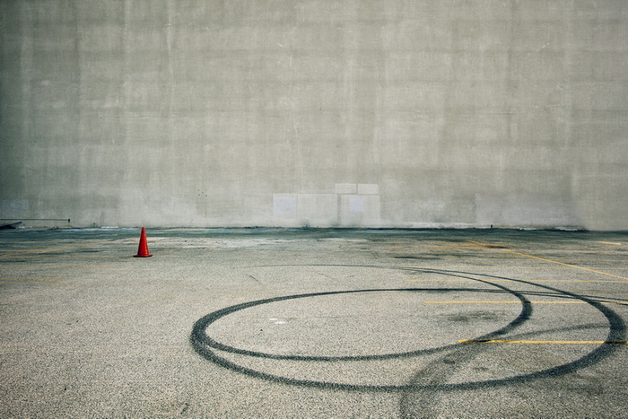 Empty Parking Lot and Orange Cone by Jeff Seltzer