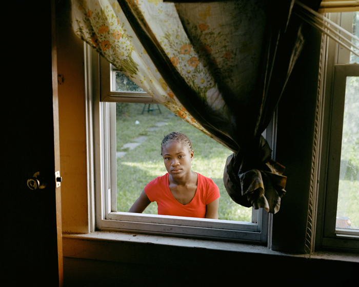 Girl In Window, Syracuse, N.Y.