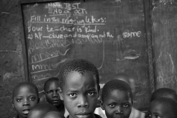 Children in Front of Chalkboard