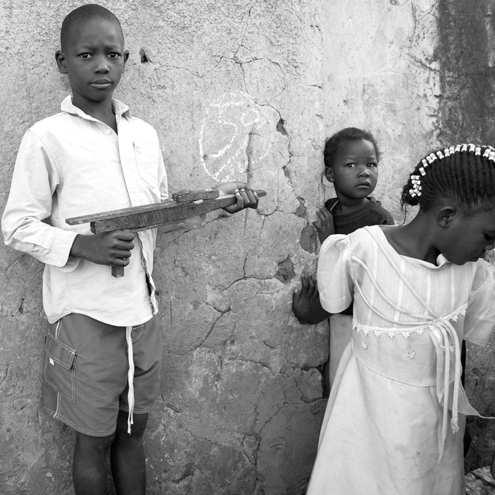 Boy with Handmade Toy Gun