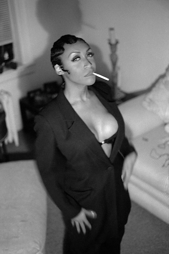 1930s black women fashion we see a woman in a blazer