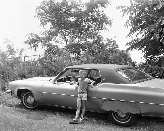Two Boys With Automobile