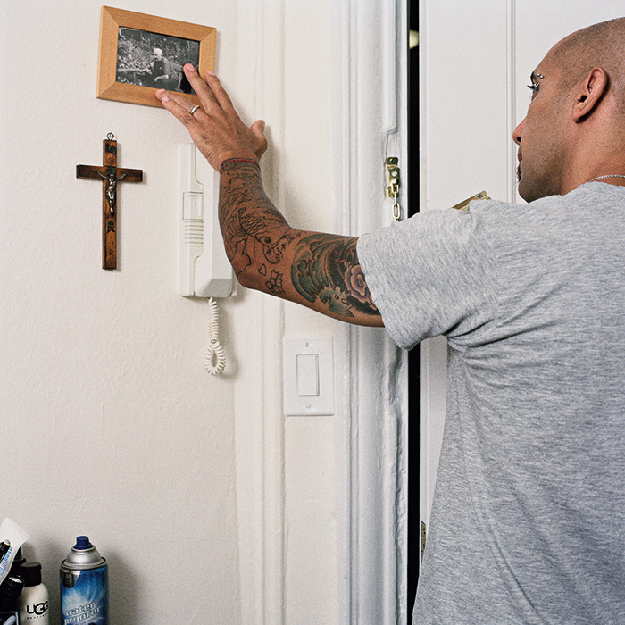 """My grandfather's picture went up on the wall as soon as we moved into this apartment. Richard has taken to touching it along with the cross (that came from my grandparents' home) every time before leaving.This ritual helps him connect with the soul of  a loving man he never met. My stories about my grandfather carry the special affection he had for me, and since we  both grew up with poor father figures, this gesture seems to fill the void in his heard as it does in mine."" – Ewelina"