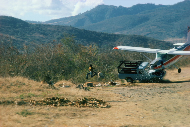 Robert Madden, Sanarete, Guatemala, 1976 A plane delivering aid to earthquake victims is caught in fierce crosswinds and crashes into a pickup truck near Sanarete, Guatemala