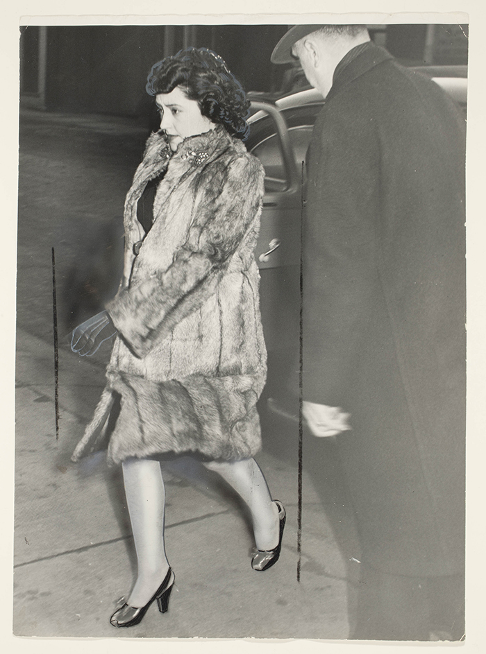 Unidentified Photographer,  Looking stouter after months of close confinement, Mrs. Evelyn Dick leaves Hamilton, Ontario jail on her way to the court house , 1947