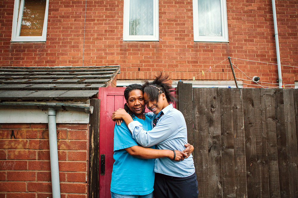 "Amy and her mum, Louisa, outside their house, Clapton, 2008 Originally from the Caribbean island Monserrat, Amy's mum Louisa has single-handedly raised 5 children in Clapton. Louisa has made sure her children have a connection to where they came from. Amy says this has helped build up her sense of self; ""Mum has always tried to show me that this (Hackney) isn't the be all and end all."""