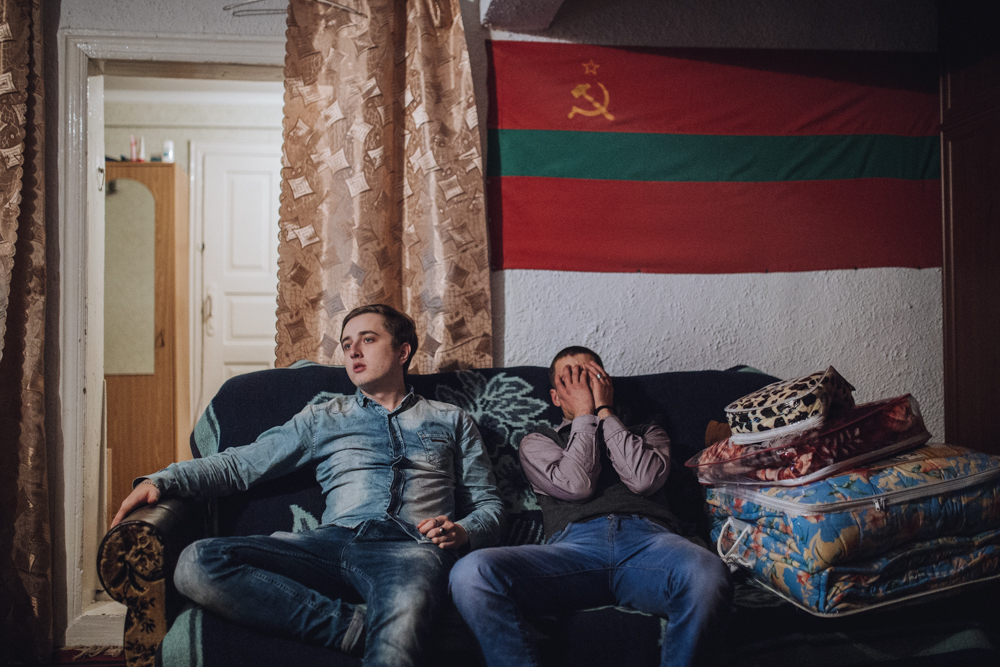 Alyosha and Yura are sitting under the flag of Transnistria.