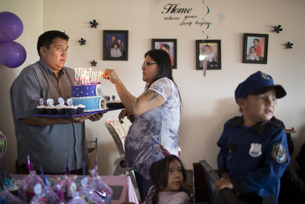 Naomi's 2nd birthday Mike Koostachin holds the cake while his wife Charlotte Nakoochee lights the candles during a birthday party for two-year-old Naomi who was adopted by the pair. Naomi's mother Kayla Nakoochee passed away in March by suicide.