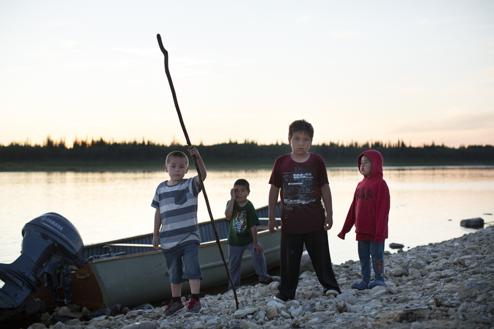 Young people Young people at the banks of the Albany River during the first Fort Albany Sundance.