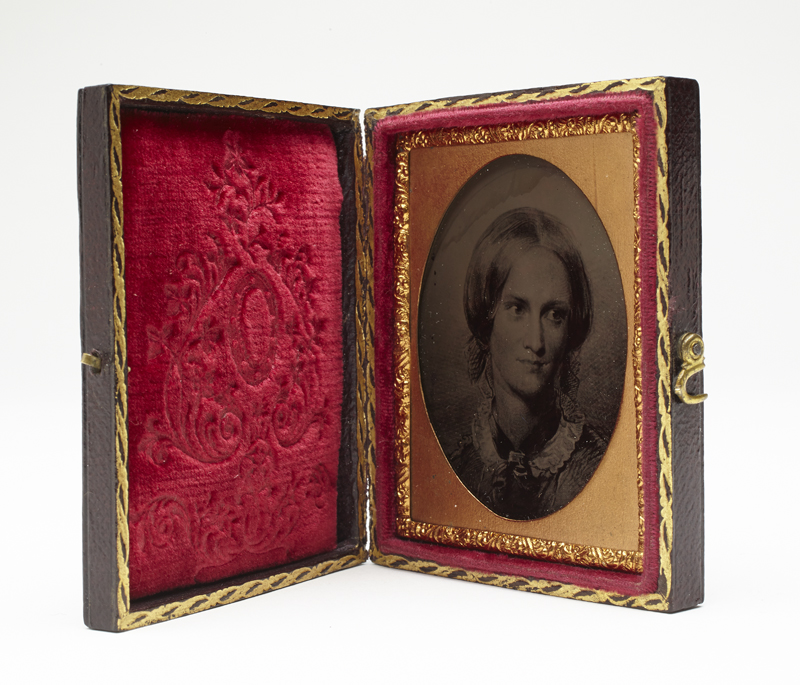 Unknown. Charlotte Brontë (1816-1855), from engraving after drawing by George Richmond 1850, 1858. Ambrotype: ninth plate. Case: brown leather with medallion and scroll design, interior with embossed red velvet pad, Overall (glass): 6.4 x 5 cm (2 1/2 x 1 15/16 in.) Frame: 7.2 x 5.9 cm (2 13/16 x 2 5/16 in.). Gift of Ronald Hewat, Kaslo, B.C., 1925.