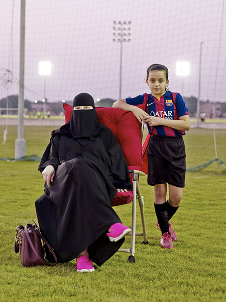 Latifa with her daughter Juriyah before a soccer game