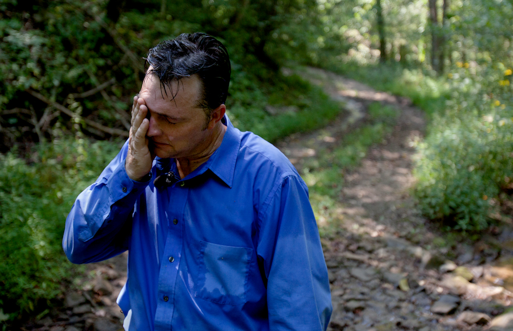 Pastor Mack Wolford on a serpent hunt during a documentary film shoot, near Jolo, West Virginia, September 2011