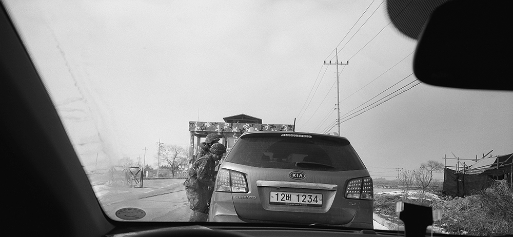 Car entering restricted area for civilians, 2014