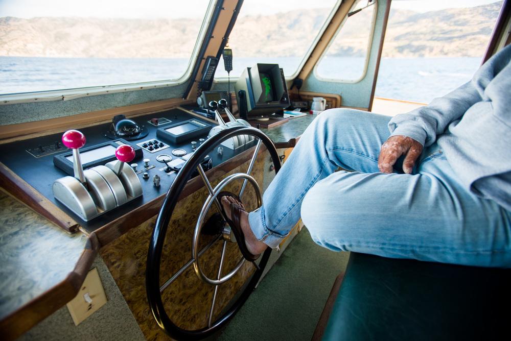 Inside the wheelhouse with the Captain.