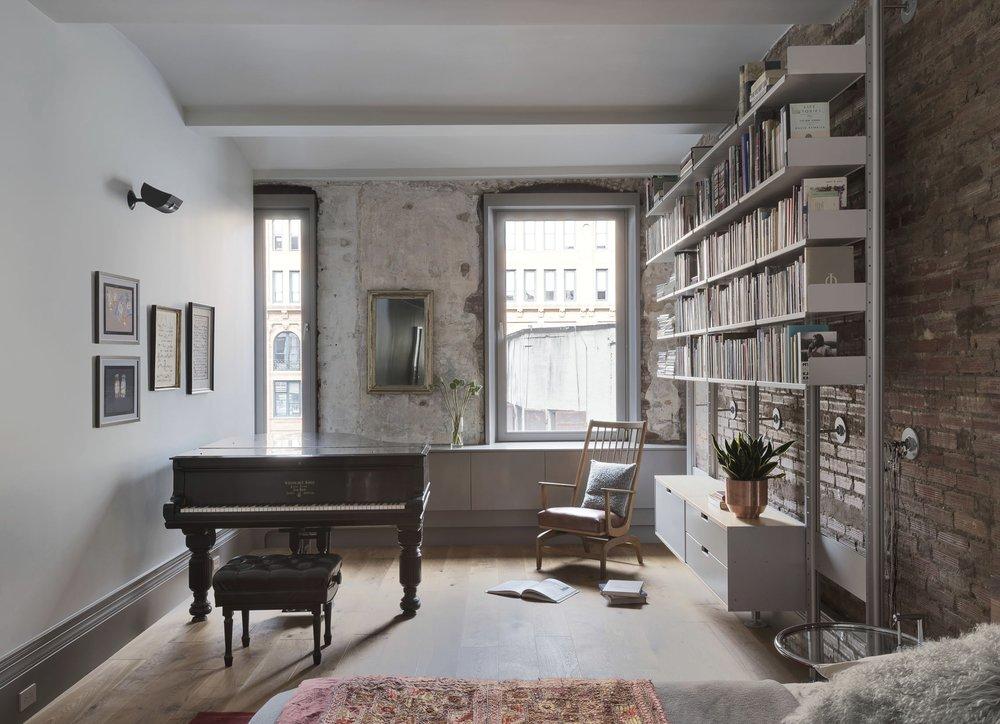 12th Street Loft Master Bedroom Piano and Bookshelf
