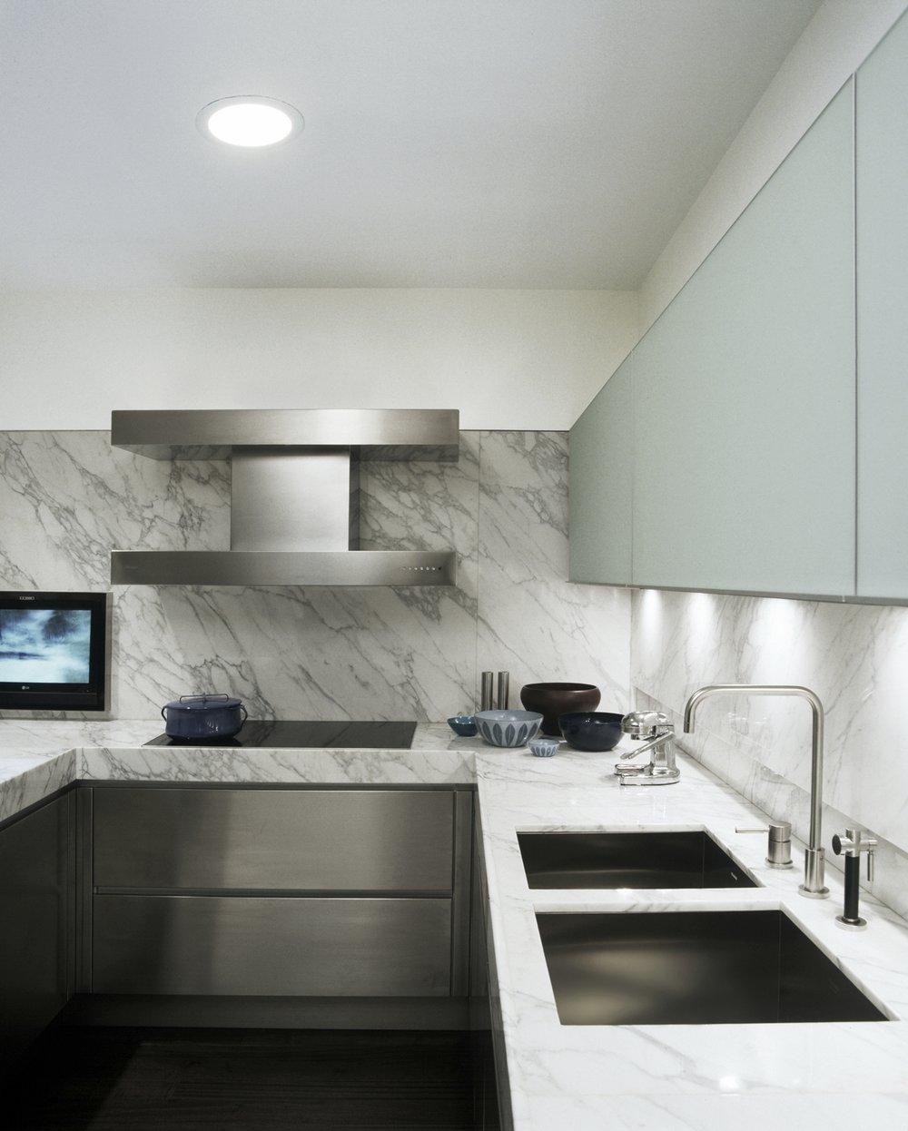 Adam Rolston, Gabriel Benroth, Drew Stuart, NYC, New York, European, apartment, kitchen, marble, cabinet, sink, faucet, stove, vent, TV, counter