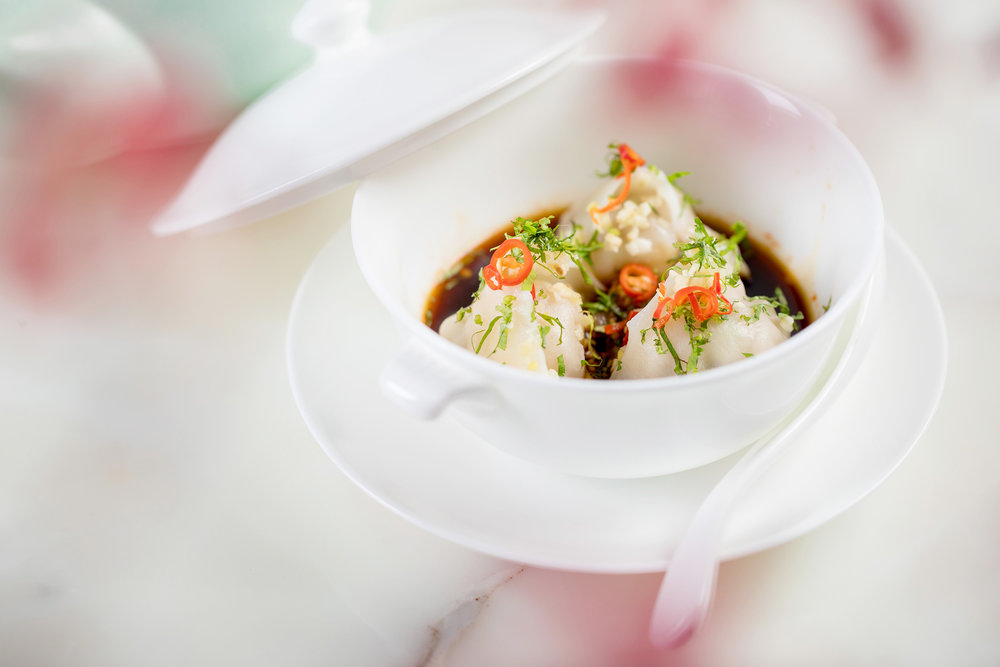 Poached Peking dumpling with chilli coriander and garlic sauce_3Q3A8185.jpg