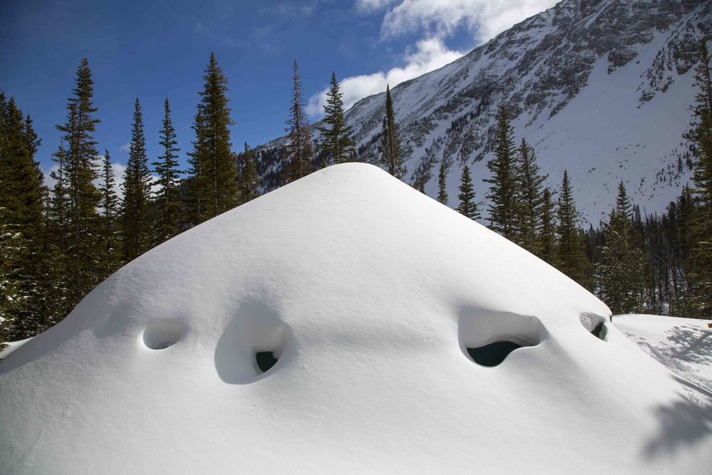 Montana backcountry yurt under feet of snow.
