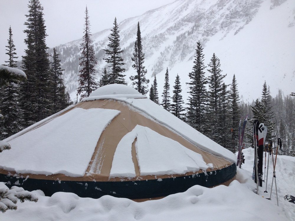 Montana backcountry yurt buried in snow.