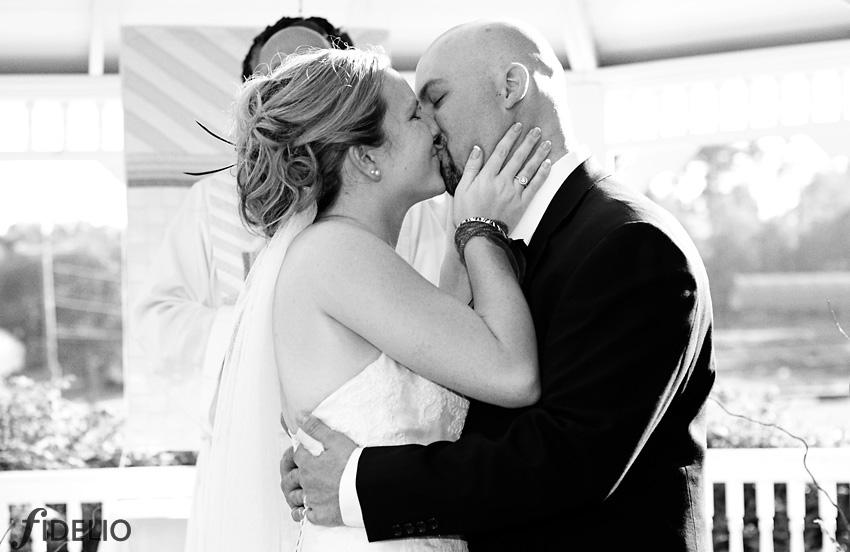 dave & taylor wedding kiss