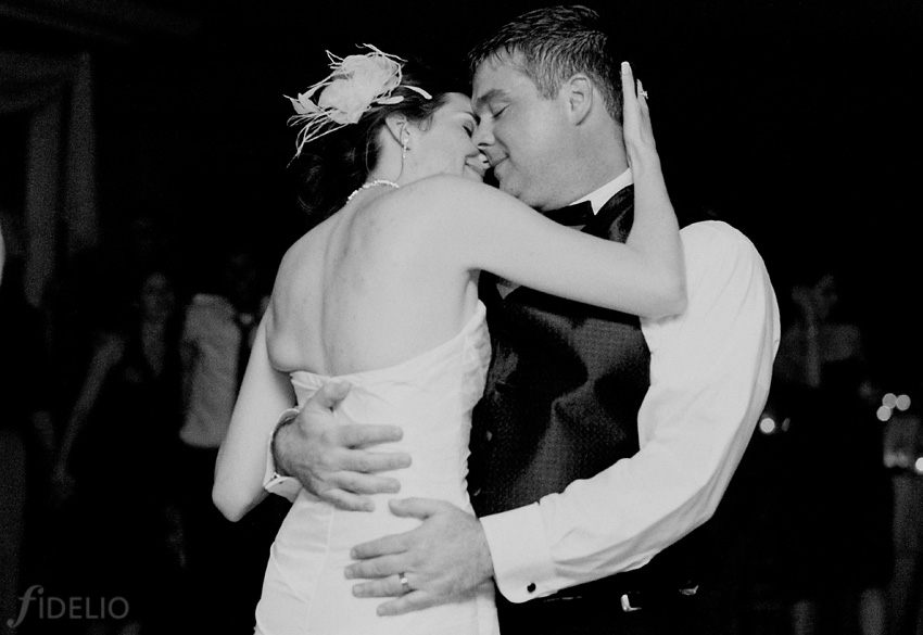 bride & groom hugging