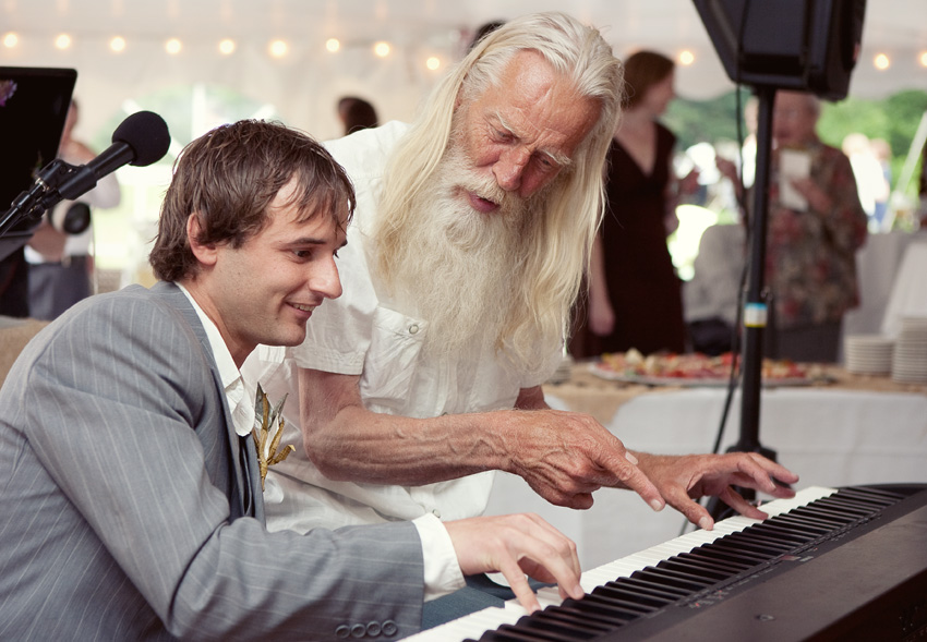 groom playing piano