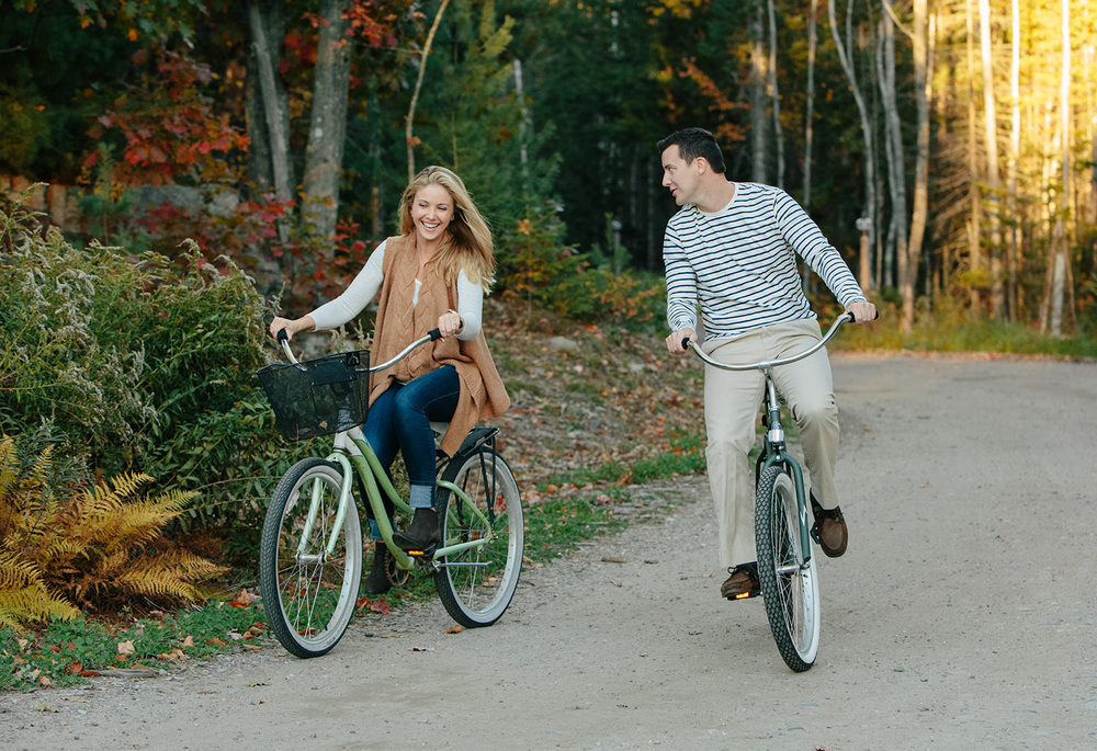 couple on bikes at hidden pond in kennebunkport