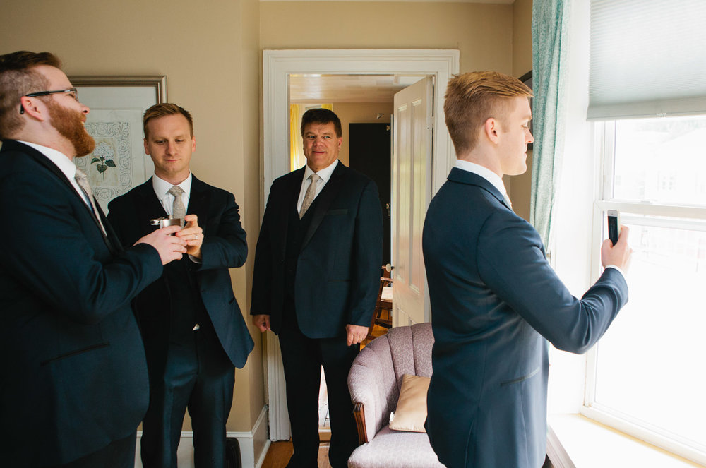 a groom takes a selfie before his maine wedding