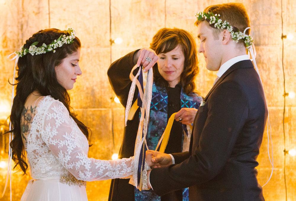 rev erika hewitt marries a bride and groom in maine