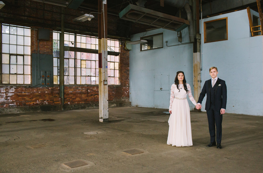 a bride and groom at the portland company complex in maine