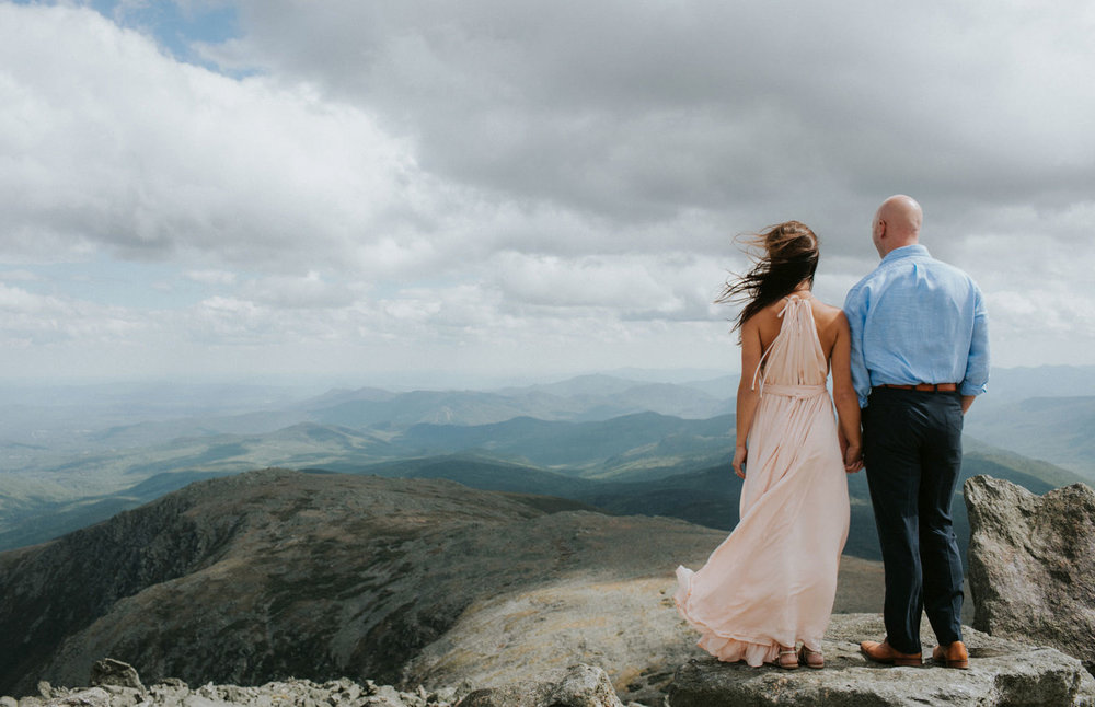 couple looking out over mount washington