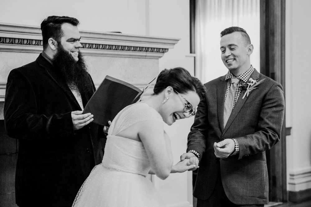 A bride and groom elope at City Hall in Portland