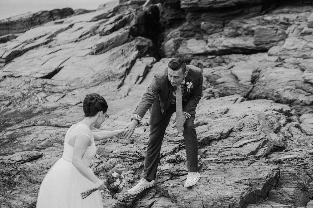 groom_helping_bride_elopement.jpg