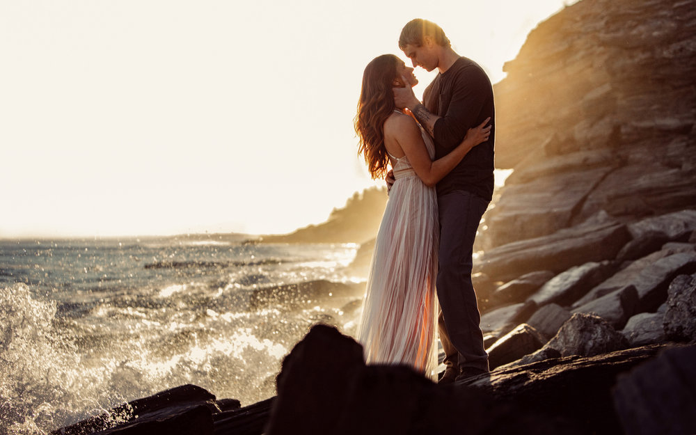 Engagement photos at sunset by the ocean